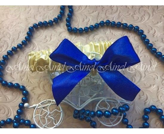 Подвязка невесты свадебная узкая айвори с синим бантом